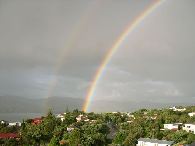 Though this was not the actual rainbow I saw, the scene was quite similar. This one is from public domain photos. Double rainbow by Andrew McMillan